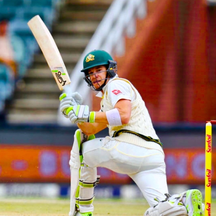 Tim Paine sweeping wearing the helmet, whites, Compression skin tights, kookaburra bat